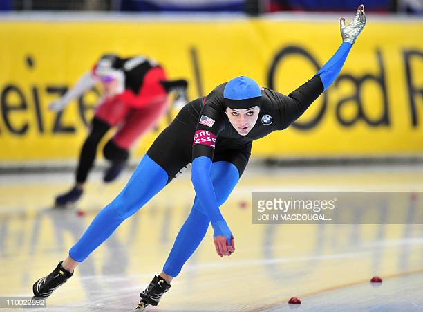 Heather Richardson of the US races to a third place as Canada's Christine Nesbitt races to victory in the women's 1000m competition of the...