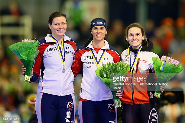 Heather Richardson of United States poses during the medal ceremony after winning the 2nd place Brittany Bowe of United States poses during the medal...