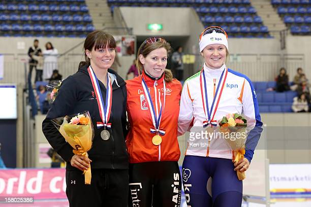 Heather Richardson of USA for second place Christine Nesbitt of Canada for first place Lotte van Beek of Netherlands for third place celebrate on the...