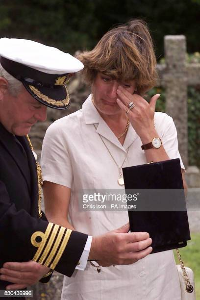 Heather Saunders the widow of Brigadier Stephen Saunders murdered in Athens by terrorists on 8/6/00 wipes a tear away from her eyes at a wreath...