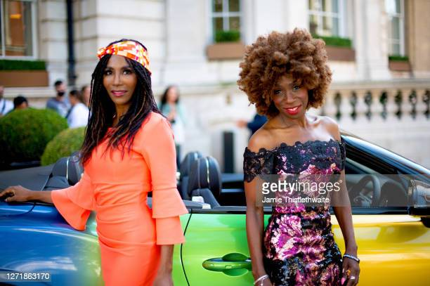 """Heather Small and Sinitta pose with the rainbow Bentley during the """"Henpire"""" podcast launch event at Langham Hotel on September 10, 2020 in London,..."""