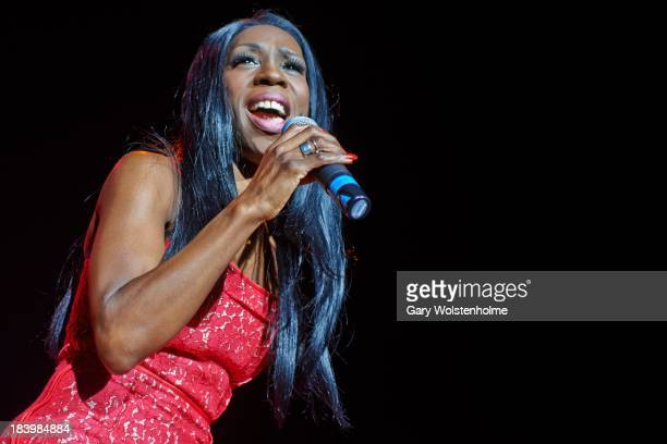Heather Small of M People performs on stage at Manchester Arena on October 10 2013 in Manchester England