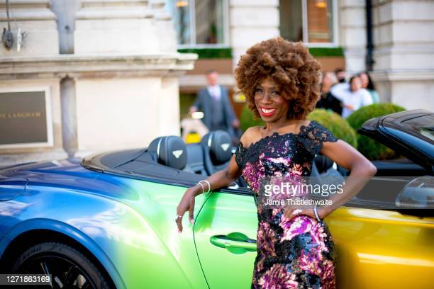 """Heather Small poses with the rainbow Bentley during the """"Henpire"""" podcast launch event at Langham Hotel on September 10, 2020 in London, England."""