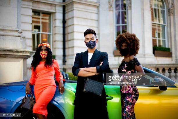 """Heather Small, Sinitta and Vincent Wong pose with the rainbow Bentley during the """"Henpire"""" podcast launch event at Langham Hotel on September 10,..."""