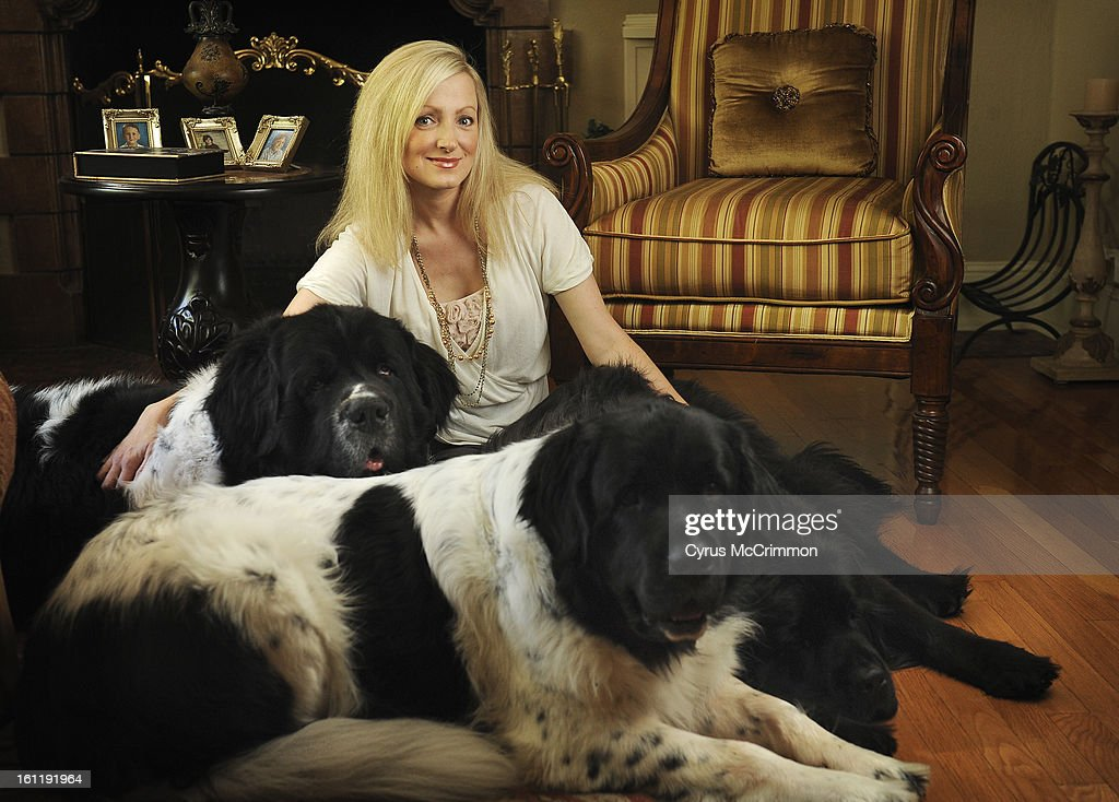 Heather Smith-Hillman at her Denver home with three Newfoundlands, Olaf, 5, left, Gladys, 2, foreground, and Opal,4, solid black right on Wednesday, August 31, 2011. Smith-Hillman has created an natural salon quality grooming products for dogs called Pure : News Photo