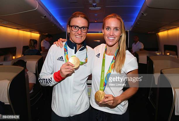 Heather Stanning and Helen Glover of Great Britain pose with their medals during the Team GB flight back from Rio on British Airways flight BA2016 on...