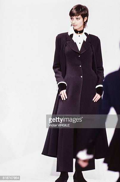 Heather Stewart Whyte walks the runway at the Claude Montana Ready to Wear Fall/Winter 1993-1994 fashion show during the Paris Fashion Week in March,...