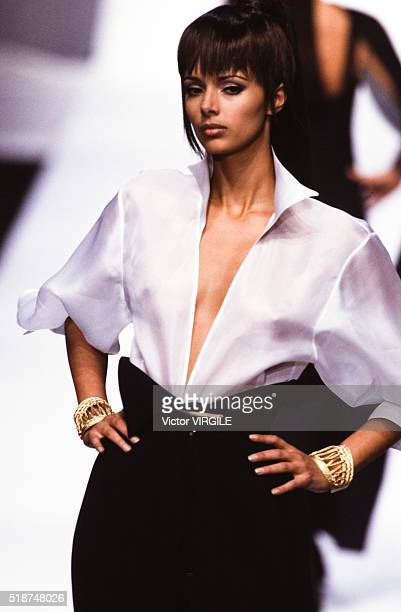 Heather Stewart Whyte walks the runway at the Claude Montana Ready to Wear Spring/Summer 19921993 fashion show during the Paris Fashion Week in...