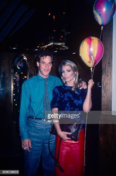 Heather Thomas holding a balloon with her boyfriend circa 1970 New York
