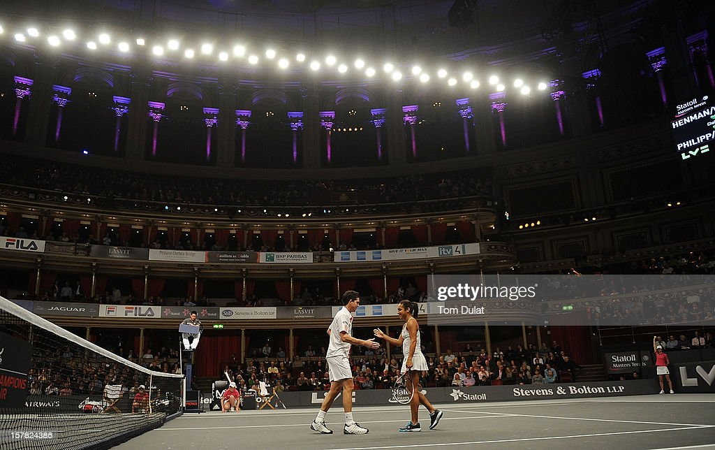 Heather Watson and Tim Henman of Great Britain during match against Mark Philippoussis of Australia and Anne Keothavong of Great Britain on Day Two of the Statoil Masters Tennis at the Royal Albert Hall on December 6, 2012 in London, England.