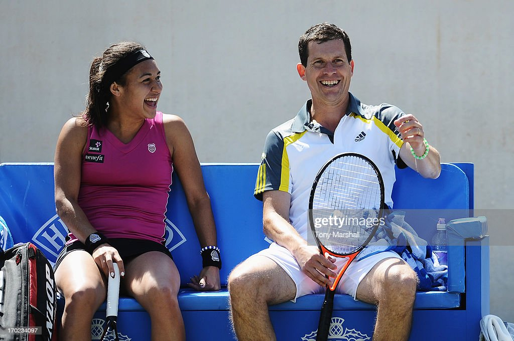 Heather Watson and Tim Henman of Great Britain laugh in their mixed doubles exhibition match against Greg Rusedski and Sorana Cirstea of Romania during day one of the AEGON Classic tennis tournament at Edgbaston Priory Club on June 9, 2013 in Birmingham, England.