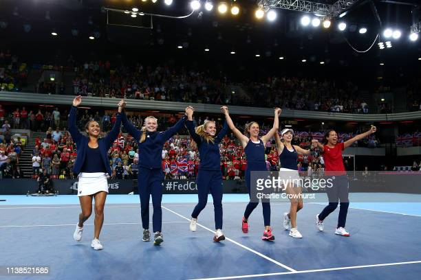 Heather Watson Harriet Dart Katie Swan Johanna Konta Katie Boulter and Captain Anne Keothavong celebrates the teams win and qualification during the...