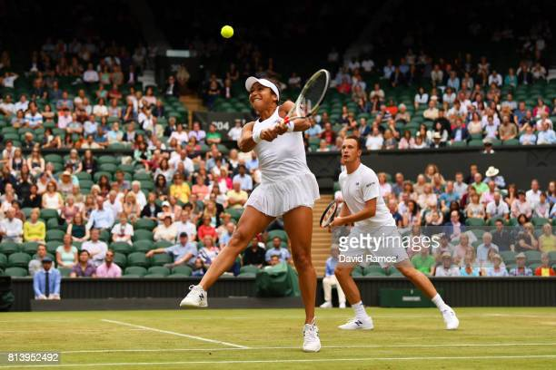 Heather Watson of Great Britain and Henri Kontinen of Finland in action in the Mixed Doubles quarter final match against Rohan Bopanna of India and...