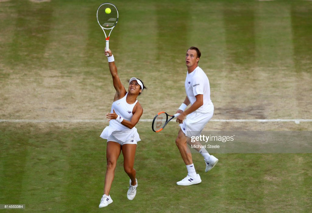 Heather Watson of Great Britain and Henri Kontinen of Finland in action during the Mixed Doubles semi final match against Elena Vesnina of Russia and Bruno Soares on day eleven of the Wimbledon Lawn Tennis Championships at the All England Lawn Tennis and Croquet Club at Wimbledon at Wimbledon on July 14, 2017 in London, England.