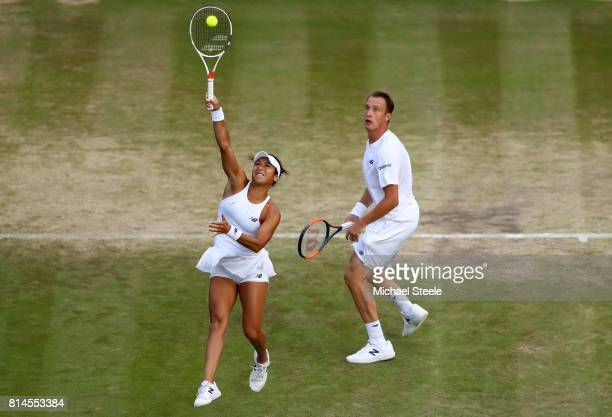 Heather Watson of Great Britain and Henri Kontinen of Finland in action during the Mixed Doubles semi final match against Elena Vesnina of Russia and...