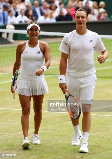 Heather Watson of Great Britain and Henri Kontinen of Finland smile during the Mixed Doubles final match against Jamie Murray of Great Britain and...