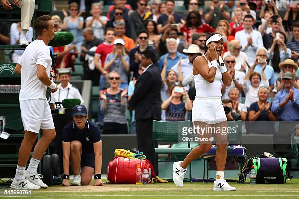 Heather Watson of Great Britain and Henri Kontinen of Finland celebrate victory during the Mixed Doubles Semi Finals match against Oliver Marach of...