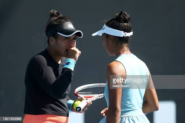 Heather Watson of Great Britain and Leylah Fernandez of Canada talk tactics in their Women's first round doubles match against Samantha Stosur of...