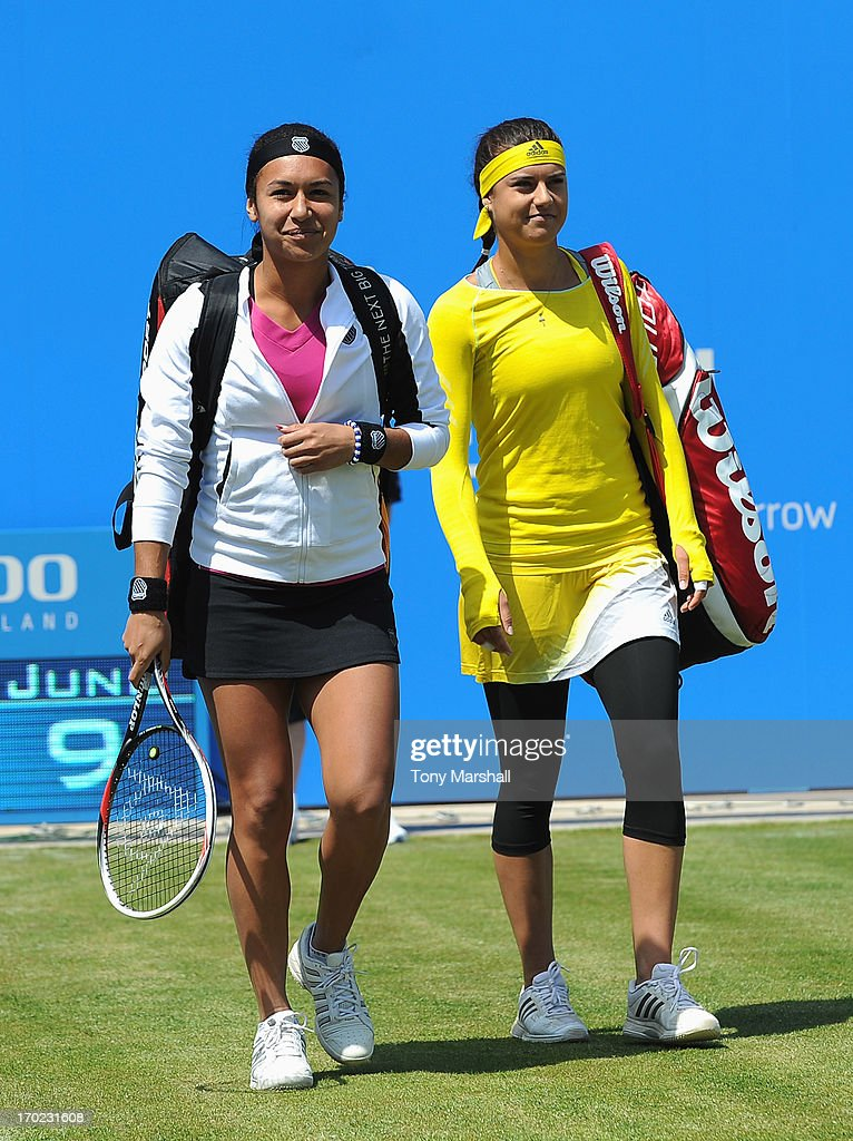 Heather Watson of Great Britain and Sorana Cirstea of Romania walk out for their mixed doubles exhibition match with respective partners Tim Henman and Greg Rusedski of Great Britain during day one of the AEGON Classic tennis tournament at Edgbaston Priory Club on June 9, 2013 in Birmingham, England.