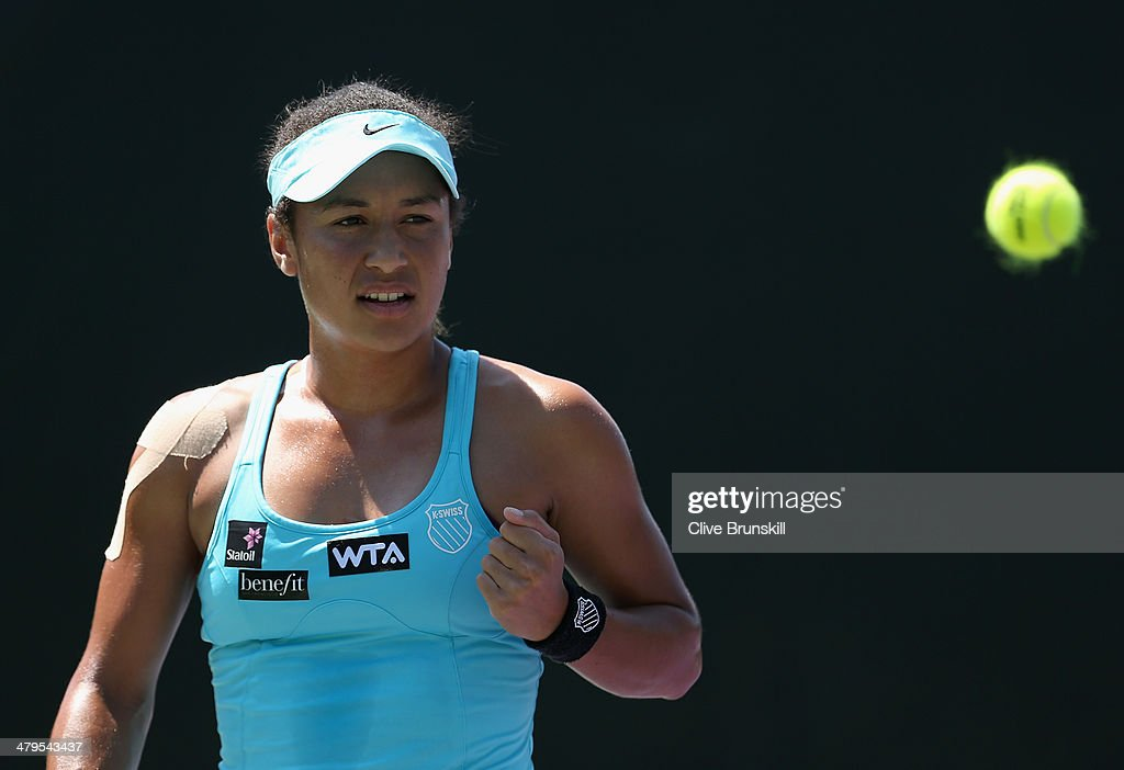 Heather Watson of Great Britain celebrates a point against Virginie Razzano of France during their first round match during day 3 at the Sony Open at Crandon Park Tennis Center on March 19, 2014 in Key Biscayne, Florida.