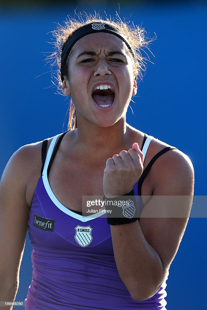 Heather Watson of Great Britain celebrates a point in her first round match against Alexandra Cadantu of Romania during day one of the 2013 Australian Open at Melbourne Park on January 14, 2013 in Melbourne, Australia.