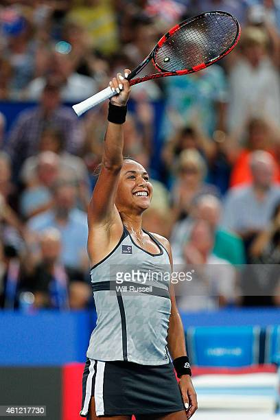 Heather Watson of Great Britain celebrates after defeating Casey Dellacqua of Australia in the women's singles match during day six of the 2015...