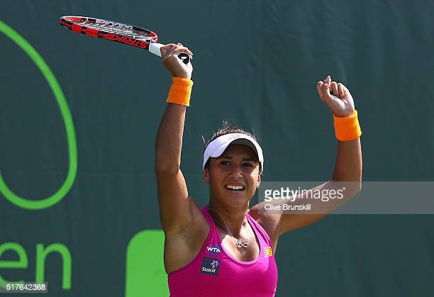 Heather Watson of Great Britain celebrates match point against Yanina Wickmayer of Belgium in their third round match during the Miami Open Presented...