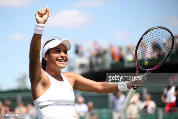 Heather Watson of Great Britain celebrates match point in her Ladies' Singles first round match against Caty McNally of the United States during Day...