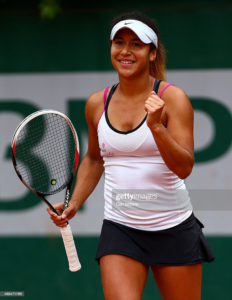 Heather Watson of Great Britain celebrates match point in her women's singles qualifying match against Anett Kontaveit of Estonia during previews ahead of the French Open at Roland Garros on May 24, 2014 in Paris, France.