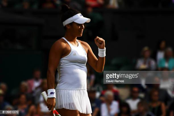 Heather Watson of Great Britain celebrates partnering Henri Kontinen of Finland in the Mixed Doubles quarter final match against Rohan Bopanna of...