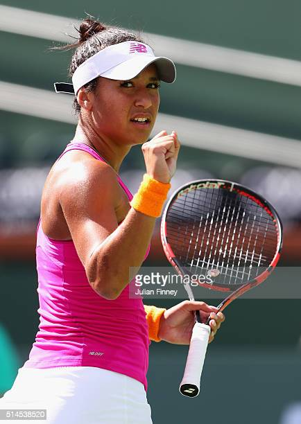 Heather Watson of Great Britain celebrates winning a games against Galina Voskoboeva of Kazakhstan during day three of the BNP Paribas Open at Indian...