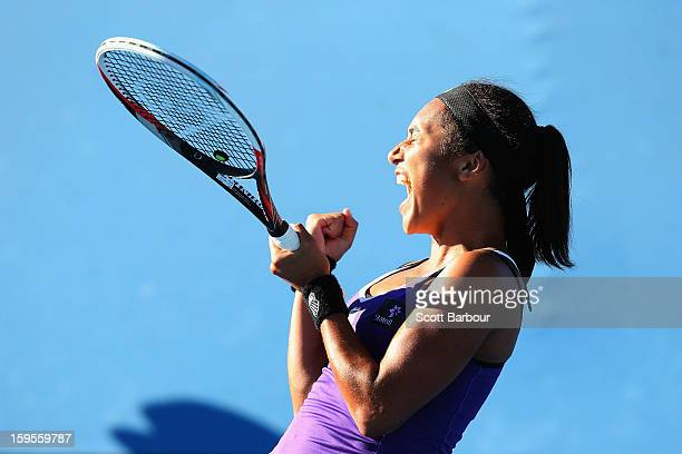 Heather Watson of Great Britain celebrates winning her second round match against Ksenia Pervak of Kazakhstan during day three of the 2013 Australian...
