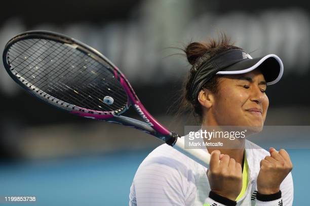 Heather Watson of Great Britain celebrates winning match point during her quarter final singles match against Elise Mertens of Belgium during day six...