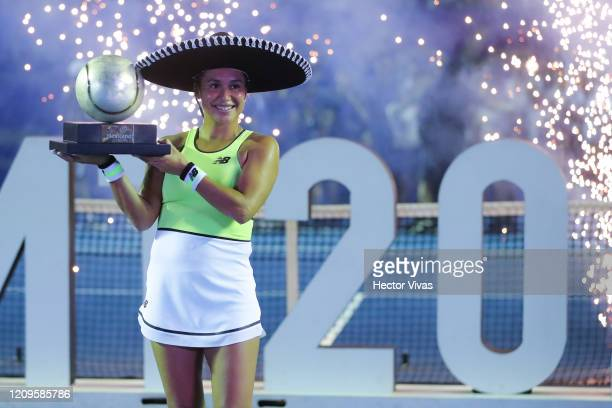 Heather Watson of Great Britain celebrates with the champion trophy after winning the singles match between Leylah Fernandez of Canada and Heather...