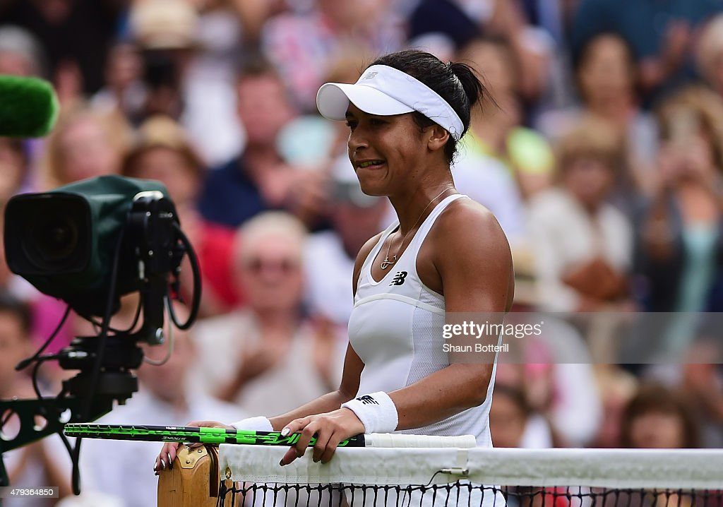 Heather Watson of Great Britain goes to the net after defeat in her Ladies' Singles Third Round match against Serena Williams of the United States during day five of the Wimbledon Lawn Tennis Championships at the All England Lawn Tennis and Croquet Club on July 3, 2015 in London, England.