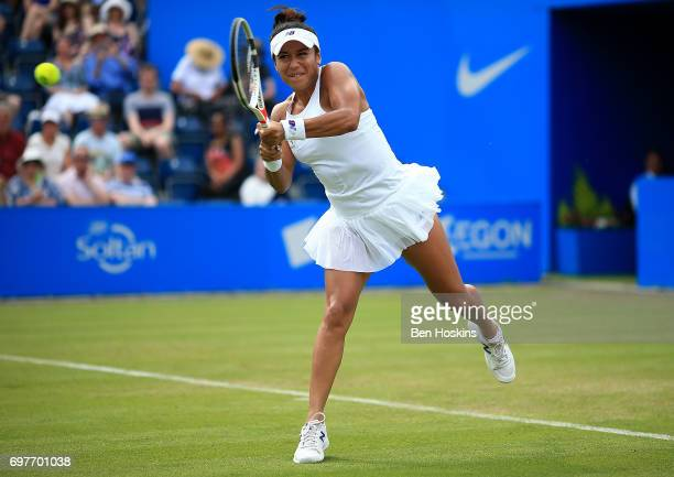 Heather Watson of Great Britain hits a backhand during the first round match against Elina Svitolina of Ukraine on day 1 of the Aegon Classic...
