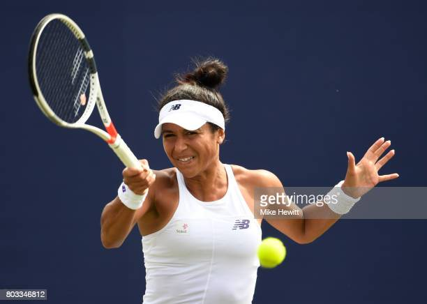 Heather Watson of Great Britain hits a forehand during the ladies singles round of 16 match against Anastasia Pavlyuchenkova of Russia on day five of...