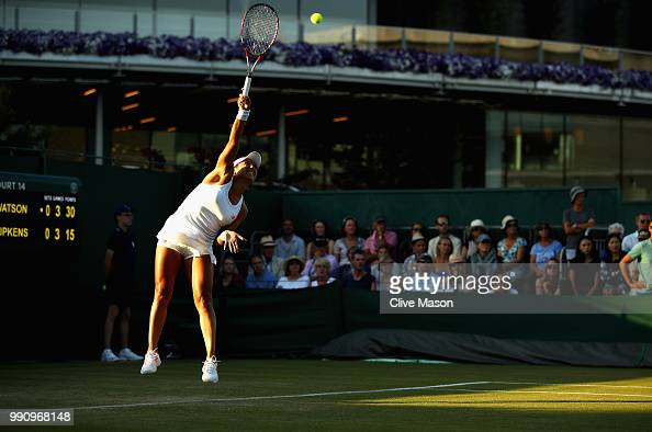 Heather Watson of Great Britain in action against Kirsten Flipkens of Belgium during their Ladies' Singles first round match at the All England Lawn...