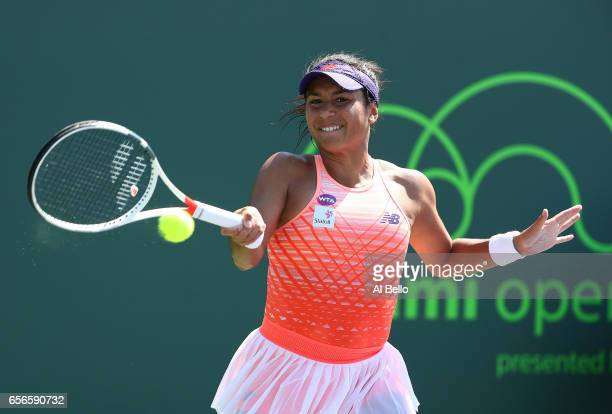 Heather Watson of Great Britain in action against Patricia Maria Tig of Romania during day 3 of the Miami Open at Crandon Park Tennis Center on March...