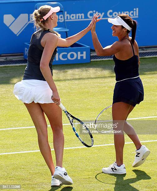 Heather Watson of Great Britain in action with Naomi Broady during their defeat to Karolina Pliskova and Barbora Strycova of Czechoslovakia in their...