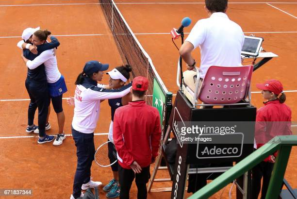 Heather Watson of Great Britain is hugged by captain Anne Keothavong after her defeat to IrinaCamelia Begu of Romania during day 2 of the Fed Cup...