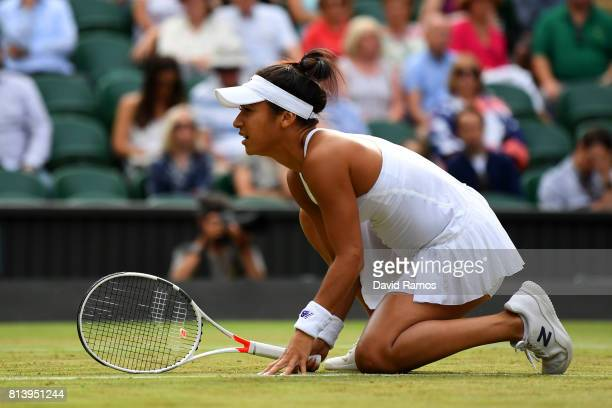 Heather Watson of Great Britain looks on partnering Henri Kontinen of Finland in the Mixed Doubles quarter final match against Rohan Bopanna of India...