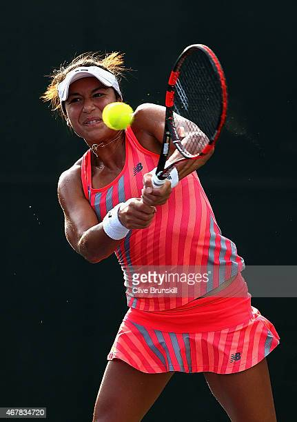 Heather Watson of Great Britain plays a backhand against Angelique Kerber of Germany in their second round match during the Miami Open Presented by...