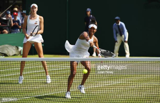 Heather Watson of Great Britain plays a backhand as partner Naomi Broady of Great Britain looks on during the Ladies Doubles first round match...