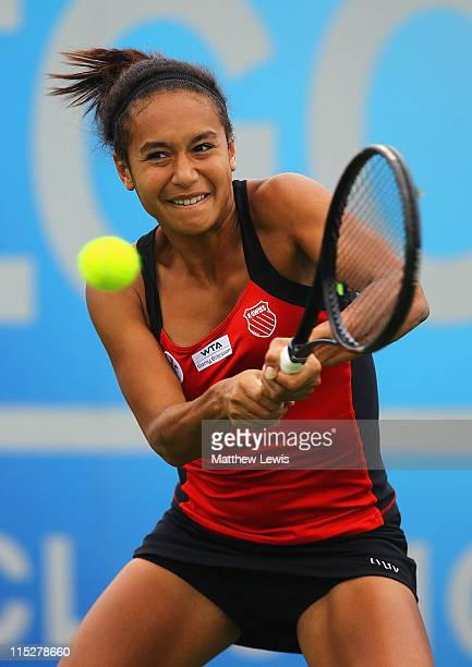 Heather Watson of Great Britain plays a backhand during her match against Chanelle Scheepers of South Africa during the first day of the AEGON...