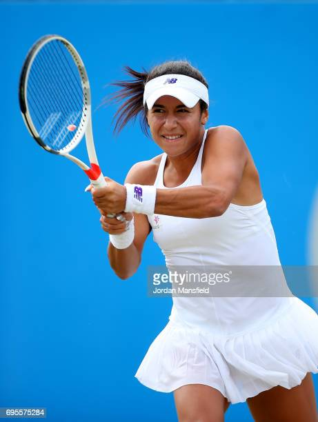 Heather Watson of Great Britain plays a backhand during her Women's first round match against Alison Riske of the USA during day two of the Aegon...
