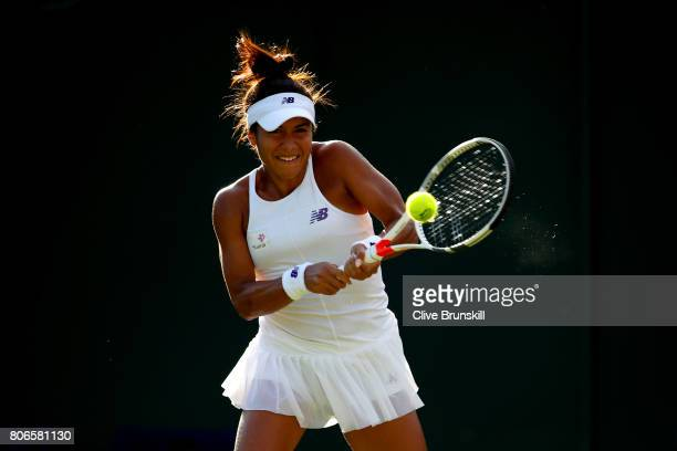 Heather Watson of Great Britain plays a backhand during the Ladies Singles first round match against Maryna Zanevska of Belgium on day one of the...