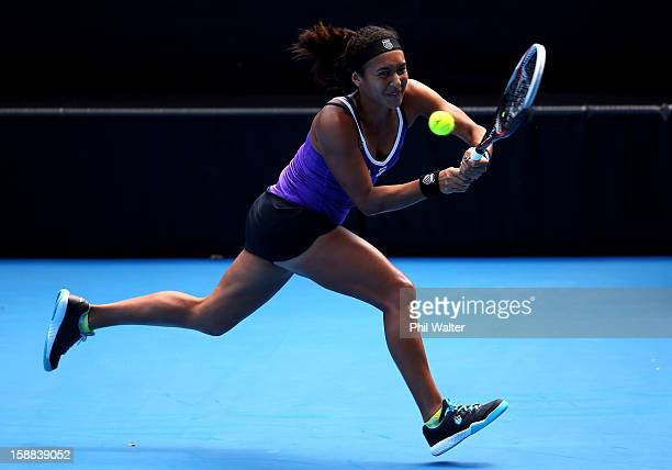 Heather Watson of Great Britain plays a backhand in her first round match against Sorana Cirstea of Romania during day two of the 2013 ASB Classic on...