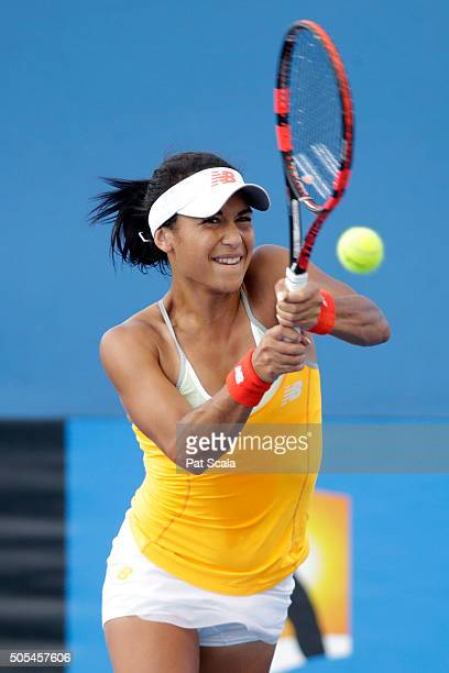 Heather Watson of Great Britain plays a backhand in her first round match against Timea Babos of Hungary during day one of the 2016 Australian Open...