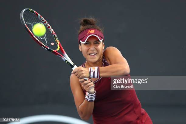 Heather Watson of Great Britain plays a backhand in her first round match against Yulia Putintseva of Kazakhstan on day two of the 2018 Australian...